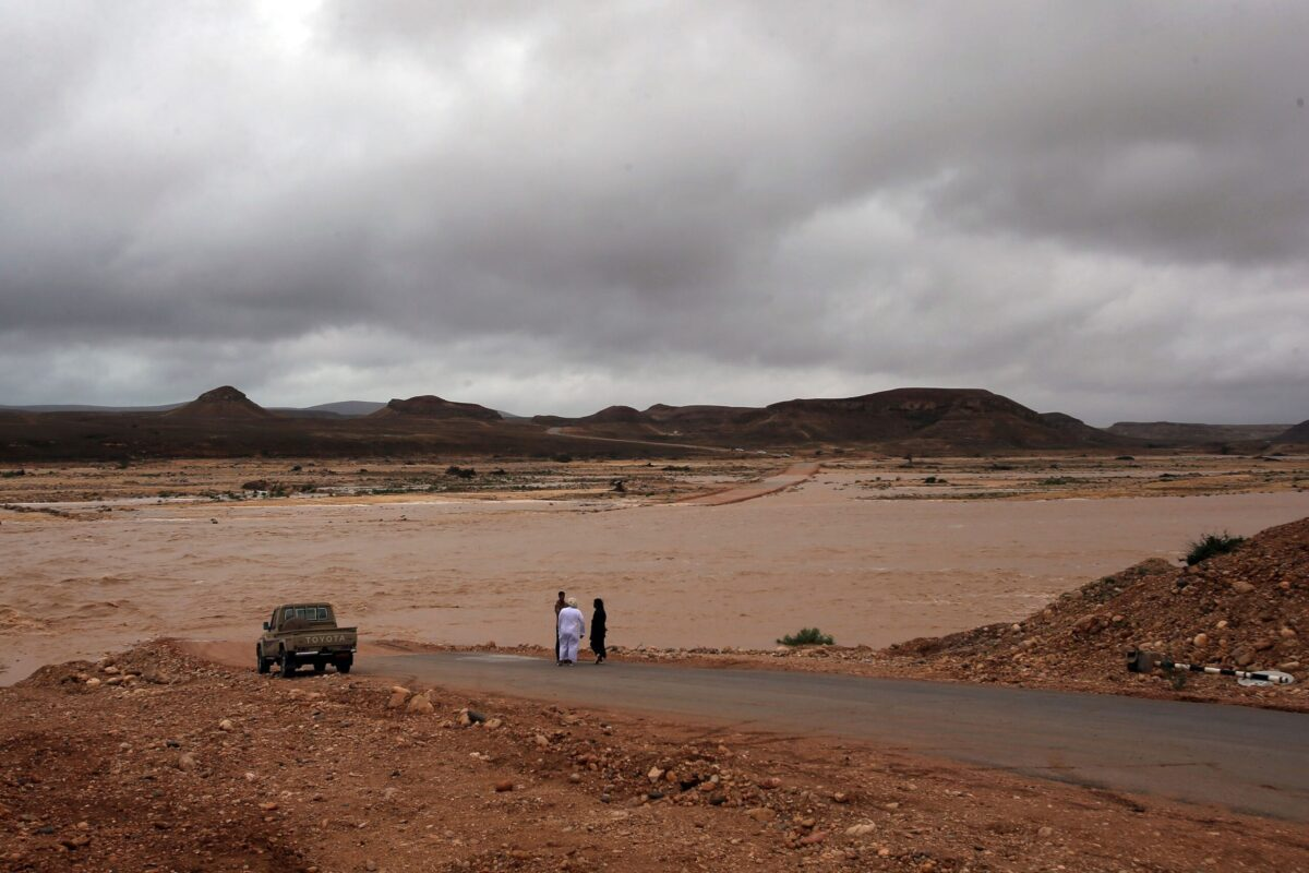 A picture taken on October 14, 2018, shows flooded streets in the Adonab valley near Salalah, in the Southern Omani province of Dhofar, during the tropical storm Luban [MOHAMMED MAHJOUB/AFP via Getty Images]