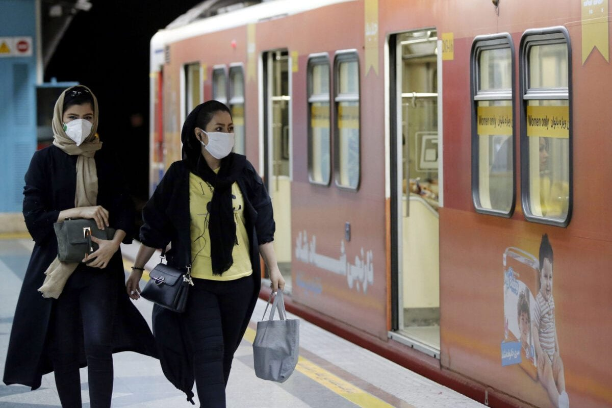 Iranian women wearing face masks leave a train in a metro station in Tehran, Iran on June 10 2020 [STRINGER/AFP via Getty Images]