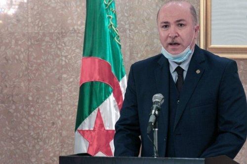The then Algerian Minister of Finance Aymen Benabderrahmane speaks during the unveiling ceremony of samples of new banknotes and a coin commemorating resistance fighters against France's colonial occupation of the North African country, in the capital Algiers, on July 4, 2020 [-/AFP via Getty Images]