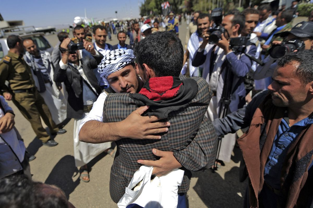 Freed Yemeni prisoners arrive in the rebel-held capital Sanaa, on October 16, 2020, as the war-torn country began swapping 1,000 prisoners in a complex operation overseen by the International Committee of the Red Cross. [MOHAMMED HUWAIS/AFP via Getty Images]