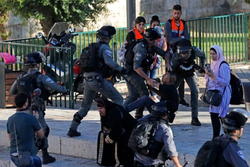 Israeli security forces detain a Palestinian outside Damascus Gate in Jerusalem's Old City on June 17, 2021 [AHMAD GHARABLI/AFP via Getty Images]
