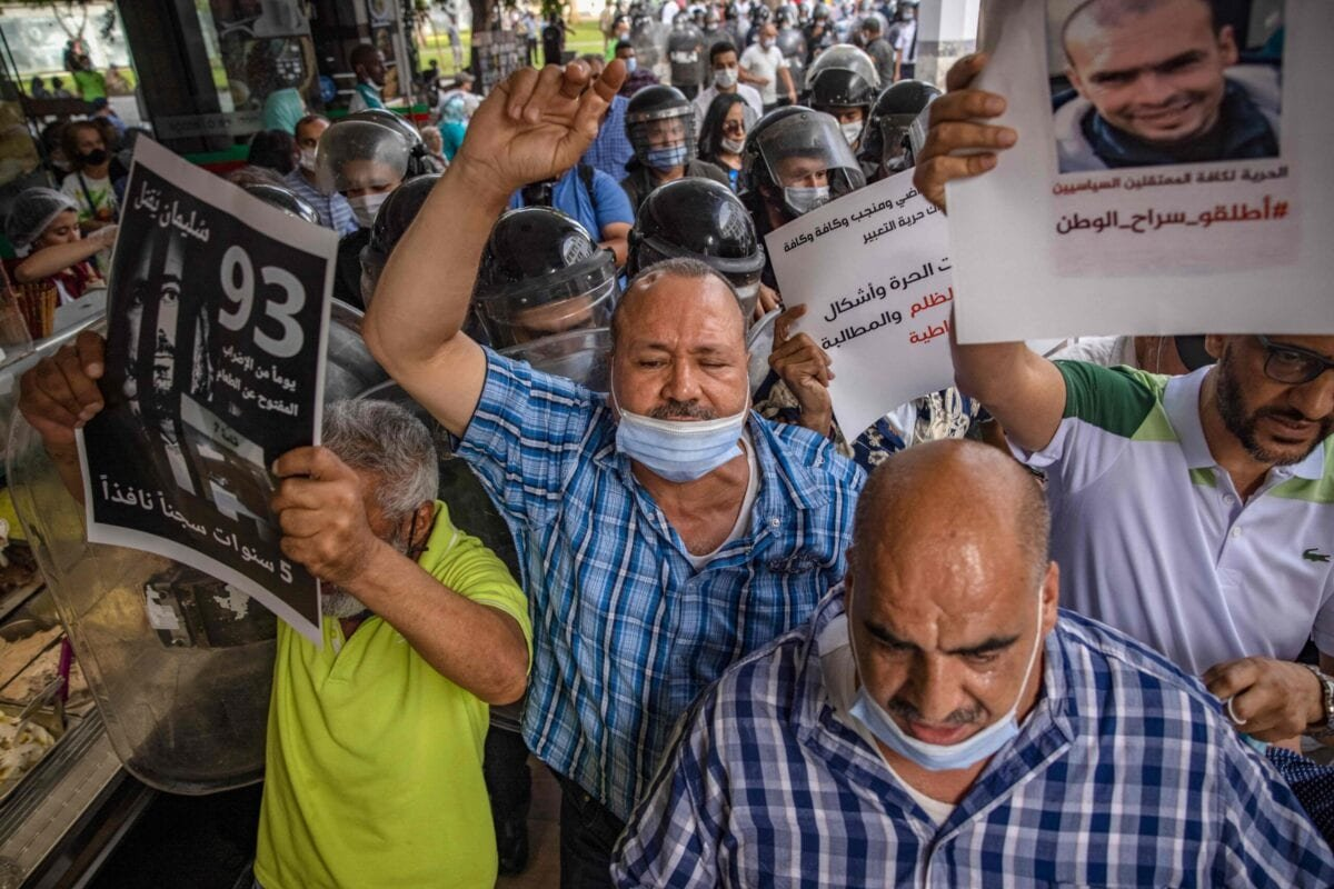Moroccan Activists chant slogans during a protest demanding the release of Moroccan journalist Soulaimane Raissouni, who was sentenced to five years in prison for 'sexual assault', in the capital Rabat on July 10, 2021 [FADEL SENNA/AFP via Getty Images]