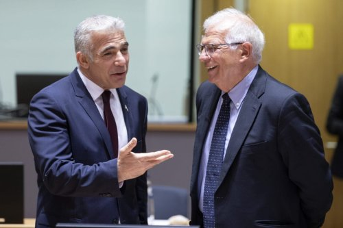 Israeli Alternate Prime Minister of Israel and Minister of Foreign Affairs Yair Lapid (L) talks with the EU Commissioner for Foreign Affairs and Security Policy - Vice President Josep Borrell (R) on July 12, 2021 in Brussels, Belgium [Thierry Monasse/Getty Images]