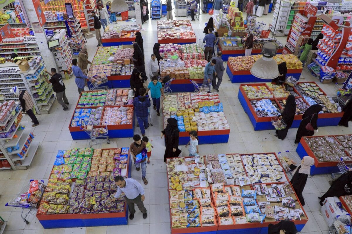 Yemenis buy sweets and nuts at a supermarket in the capital Sanaa on July 18, 2021, as Muslims prepare to celebrate the annual holiday of Eid al-Adha (Feast of Sacrifice). (Photo by MOHAMMED HUWAIS / AFP) (Photo by MOHAMMED HUWAIS/AFP via Getty Images)