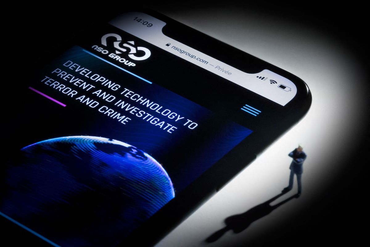 This studio photographic illustration shows a smartphone with the website of Israel's NSO Group which features 'Pegasus' spyware, on display in Paris on July 21, 2021. [JOEL SAGET/AFP via Getty Images]