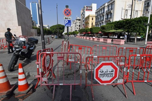 Tunisian police barricade the Habib Bourguiba avenue in Tunis on July 27, 2021. [FETHI BELAID/AFP via Getty Images]