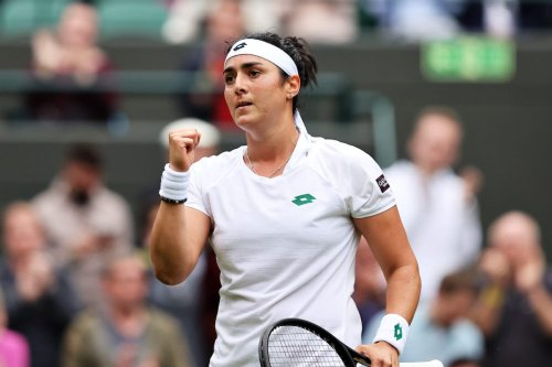 Ons Jabeur of Tunisia celebrates victory after winning her Ladies' Singles Second Round match against Venus Williams of The United States during Day Three of The Championships - Wimbledon 2021 at All England Lawn Tennis and Croquet Club on 30 June 2021 in London, England. [Clive Brunskill/Getty Images]