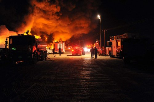 Kuwait's firefighters try to contain a massive fire in a dump for used tyres, on 17 April 2012 [YASSER AL-ZAYYAT/AFP/Getty Images]