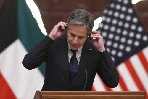 US Secretary of State Antony Blinken adjusts headphones during a joint-press conference with Kuwaiti Foreign Minister Sheikh Ahmad Nasser Al-Mohammad Al-Sabah (not seen) in Kuwait City on July 29, 2021 [Jaber Abdulkhaleg / Anadolu Agency]
