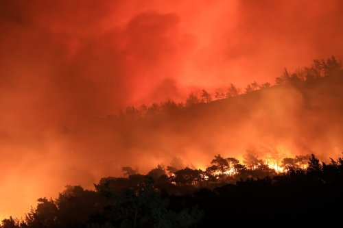 MUGLA, TURKEY - AUGUST 01: Smoke rises as fight against forest fires broke out in Marmaris district of Mugla continue with ground and aerial extinguishing operations on August 01, 2021 in Mugla, Turkey. Turkish authorities maintain their tireless efforts to contain forest fires that erupted in various parts of the country, particularly the southern regions. ( Mahmut Serdar Alakuş - Anadolu Agency )