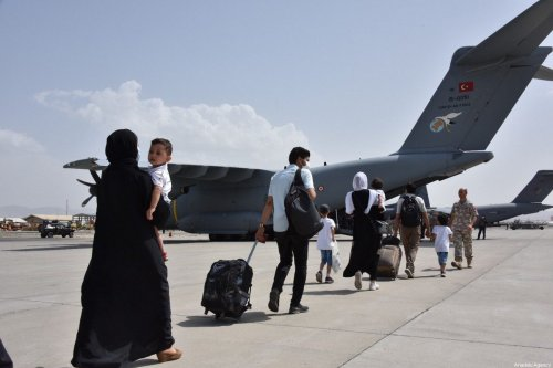 Turkish citizens seen boarding a military transport aircraft of the Turkish Armed Forces, during the evacuation of Kabul, Afghanistan on August 18, 2021 [Turkish National Defense Ministry / Anadolu Agency]