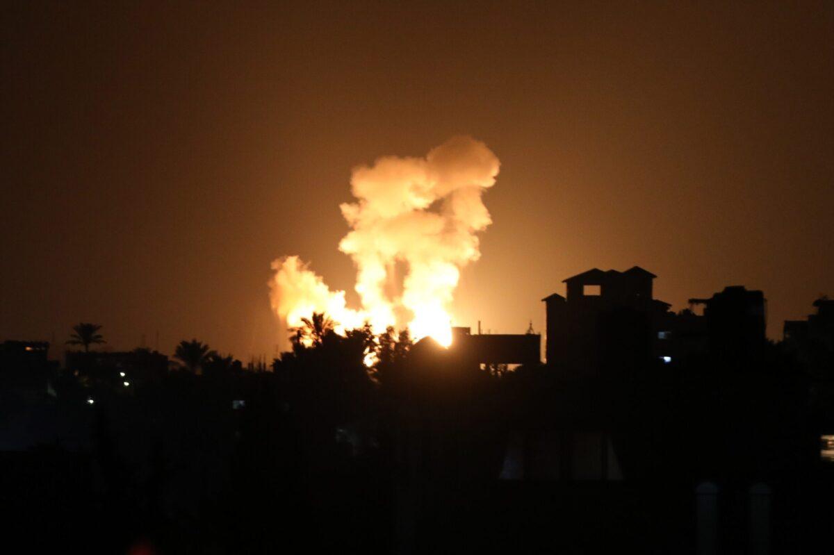 Smoke rises from a site hit by Israeli airstrikes, targeting Palestinian resistance groups' points in Khan Yunis, Gaza on August 23, 2021 [Ashraf Amra/Anadolu Agency]
