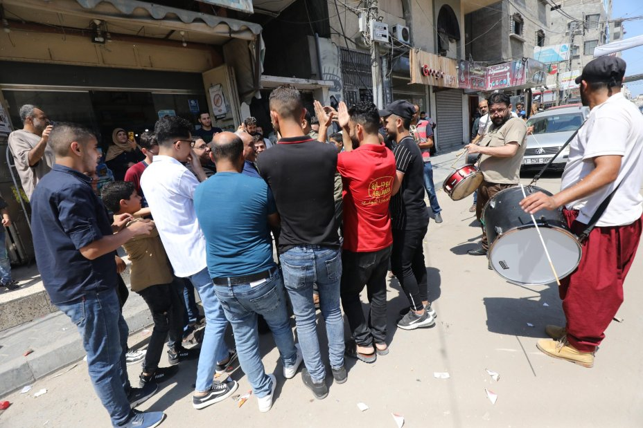 Students in Gaza celebrate their high school exam results [Mohammed Asad/Middle East Monitor]