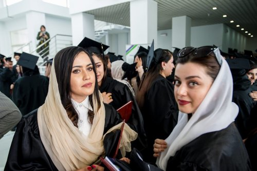 Women graduates celebrate after more than 100 Afghan students from the American University of Afghanistan (AUAF) receive their diplomas at a graduation ceremony on campus on 21 May 2019, in western Kabul, Afghanistan. [Scott Peterson/Getty Images]
