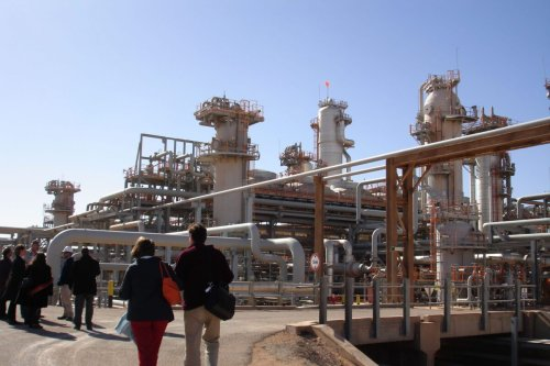 A foreign delegation visits on December 14, 2008 the Krechba gas treatment plant, about 1,200 km (746 miles) south of Algiers. The In Salah gas project, a four-year old venture grouping energy majors Sonatrach of Algeria, BP of Britain and Statoil of Norway, is described by its managers as the world's first and largest onshore carbon capture and sequestration scheme. The Organization of Petroleum Exporting Countries (OPEC) is due to meet on December 17, 2008 in the Algerian city of Oran. AFP PHOTO / STR (Photo by STR / AFP) (Photo by STR/AFP via Getty Images)