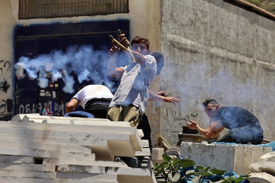 Palestinian youths protest against Israeli occupation in the village of Beita, south of Nablus, in the occupied West Bank on 8 June 2021. [JAAFAR ASHTIYEH/AFP via Getty Images]