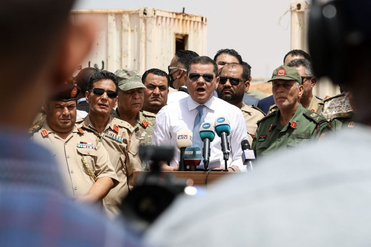 Libyan Interim Prime Minister Abdulhamid Dbeibah, delivers a speech on June 20, 2021, in the town of Buwairat al-Hassoun, during a ceremony to mark the reopening of 300-kilometre road between the cities of Misrata and Sirte [MAHMUD TURKIA/AFP via Getty Images]