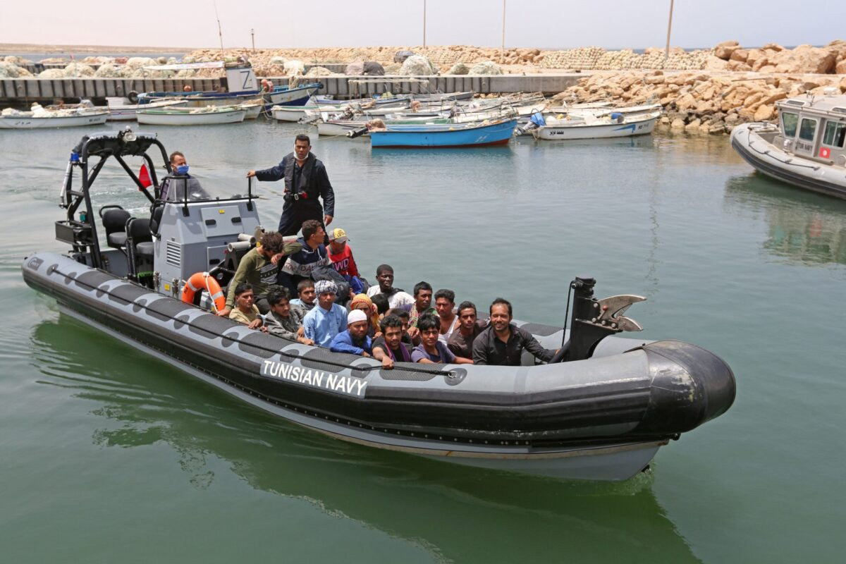 Migrants rescued by Tunisia's national guard during an attempted crossing of the Mediterranean by boat arrive at the port of el-Ketef in Ben Guerdane in southern Tunisia near the border with Libya on June 27, 2021 [FATHI NASRI/AFP via Getty Images]