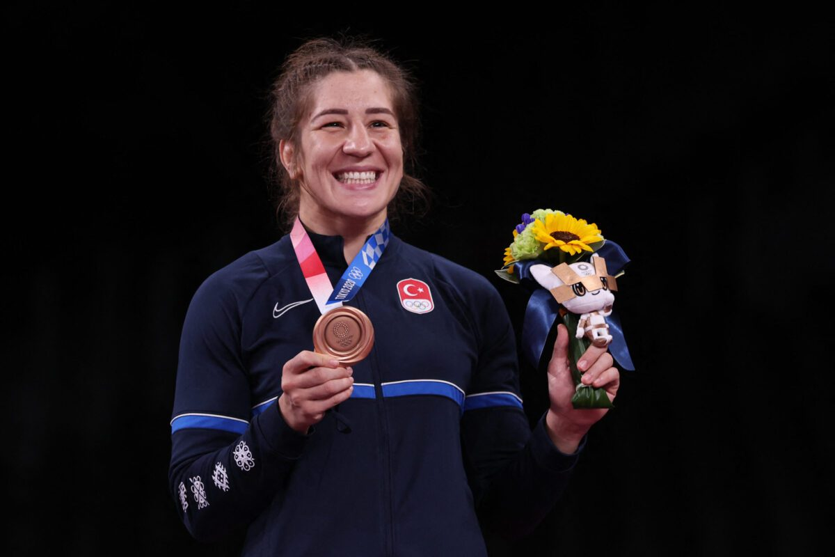 Bronze medalist Turkey's Yasemin Adar poses on the podium after the women's freestyle 76kg wrestling competition of the Tokyo 2020 Olympic Games at the Makuhari Messe in Tokyo on August 2, 2021 [JACK GUEZ/AFP via Getty Images]