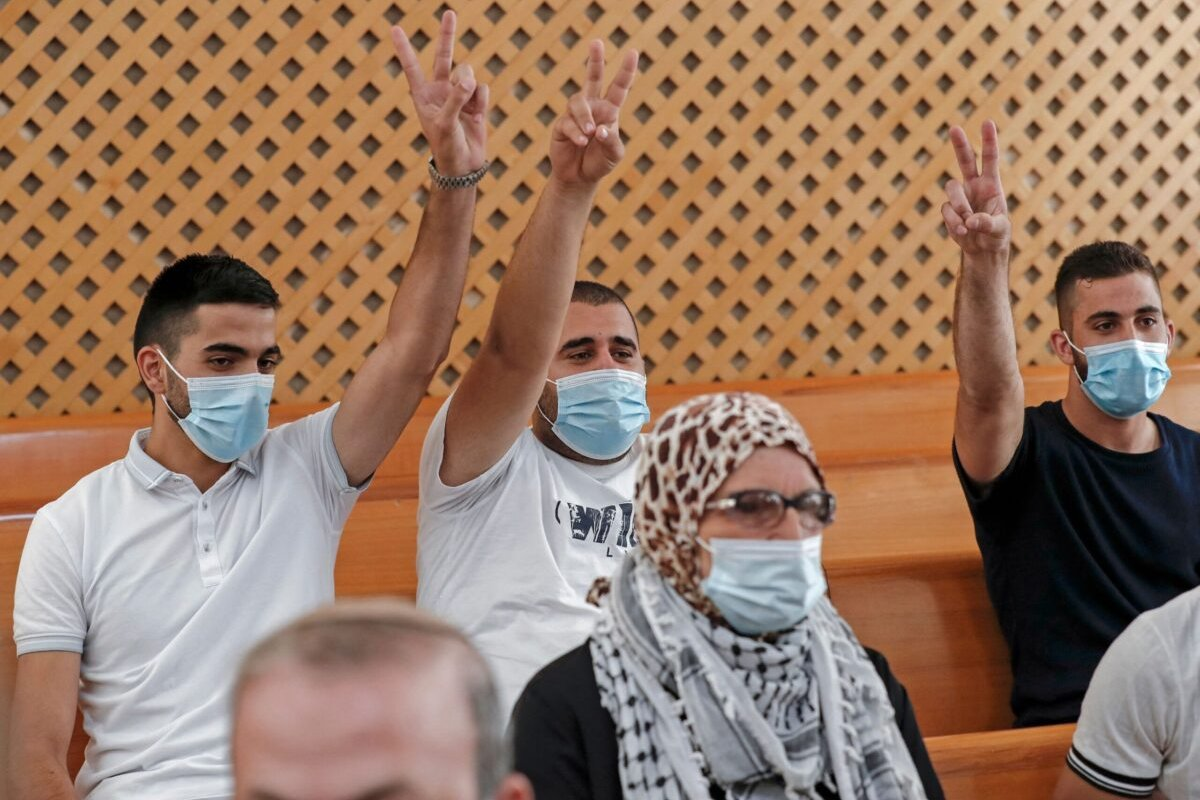 Palestinian residents of the Sheikh Jarrah neighbourhood attend a hearing at Israel's supreme court in Jerusalem on August 2, 2021 [AHMAD GHARABLI/AFP via Getty Images]