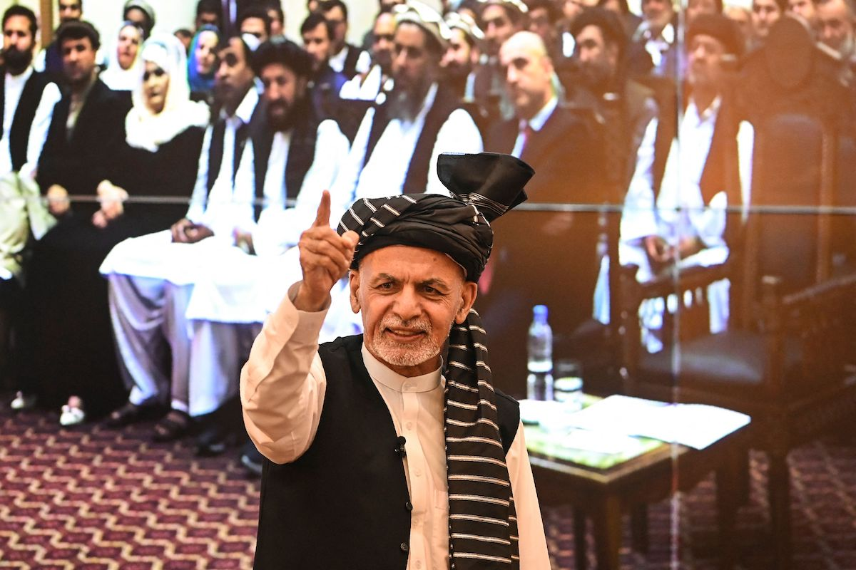 Afghanistan's President Ashraf Ghani gestures during a function at the Afghan presidential palace in Kabul on 4 August 2021. [SAJJAD HUSSAIN/AFP via Getty Images]