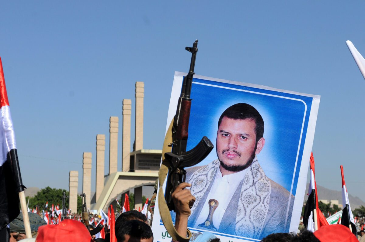 SANA'A, YEMEN - MARCH 26: A Yemeni holds up a picture of the Houthi leader Abdulmalik al-Houthi during a rally held to mark the third anniversary of the Saudi-led coalition war on Yemen on March 26, 2018 in Sana'a, Yemen. (Photo by Mohammed Hamoud/Getty Images)