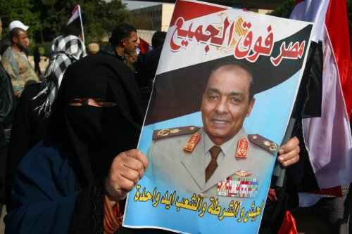 An Egyptian woman holds up a poster picturing Field Marshal Hussein Tantawi, in Cairo, Egypt on 25 January 2012 [AMRO MARAGHI/AFP/Getty Images]