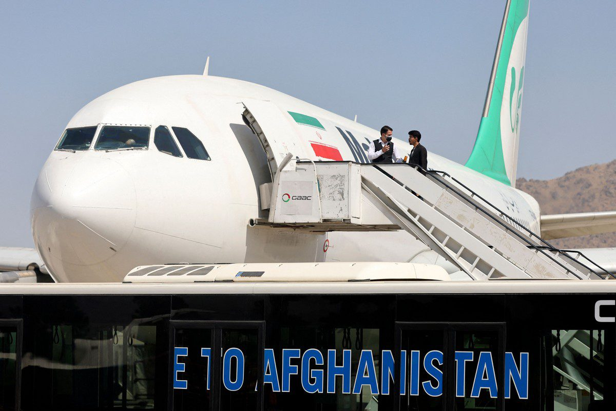 Passengers leave the Iranian airline Mahan Air flight at the airport in Kabul, Afghanistan on 15 September 2021 [KARIM SAHIB/AFP/Getty Images]