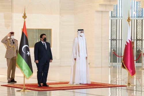 Chairman of the Presidential Council of Libya, Mohamed al-Menfi (L) meets Qatari Emir Sheikh Tamim bin Hamad al-Thani (R) during his official visit at Amiri Diwan in Doha, Qatar on 15 September 2021. [Libyan Presidential Council - Anadolu Agency]