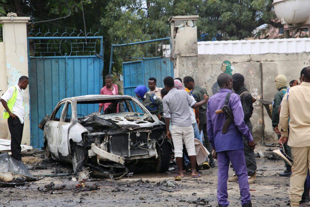 Crime scene officials inspect the suicide car bombing area in Mogadishu, Somalia on September 25, 2021 [Sadak Mohammed/Anadolu Agency]