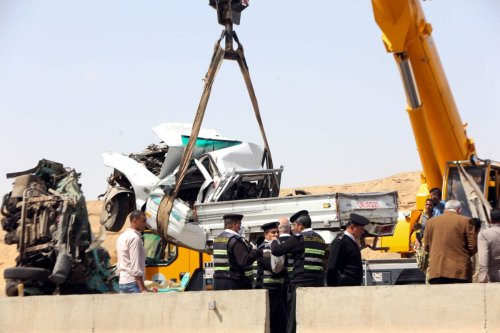 Workers remove the wreckage of a car at the site of a road accident near the town of Al-Saff in Cairo's northern Giza province, some 40 kilometres North of the capital, on March 26, 2020 [KHALED KAMEL/AFP via Getty Images]