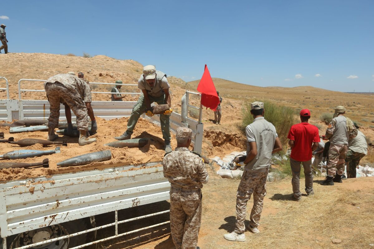 Military engineers of the UN-recognised Libyan Government of National Accord (GNA) collect mines and explosive devices uncovered from areas south of the capital Tripoli, on July 22, 2020 [MAHMUD TURKIA/AFP via Getty Images]