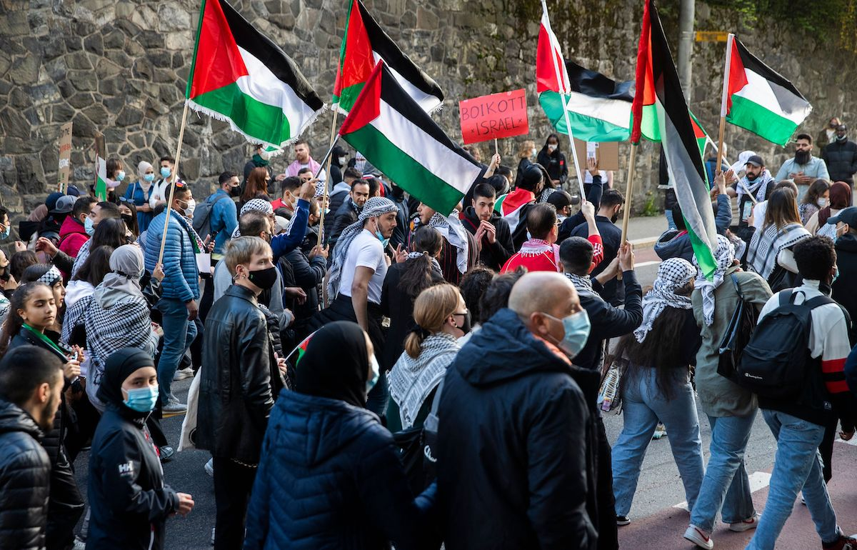 Demonstrators wave Palestinian flags as people gather on May 19, 2021 in Oslo, Norway, in solidarity with the Palestinians in the Gaza Strip [BERIT ROALD/NTB/AFP via Getty Images]