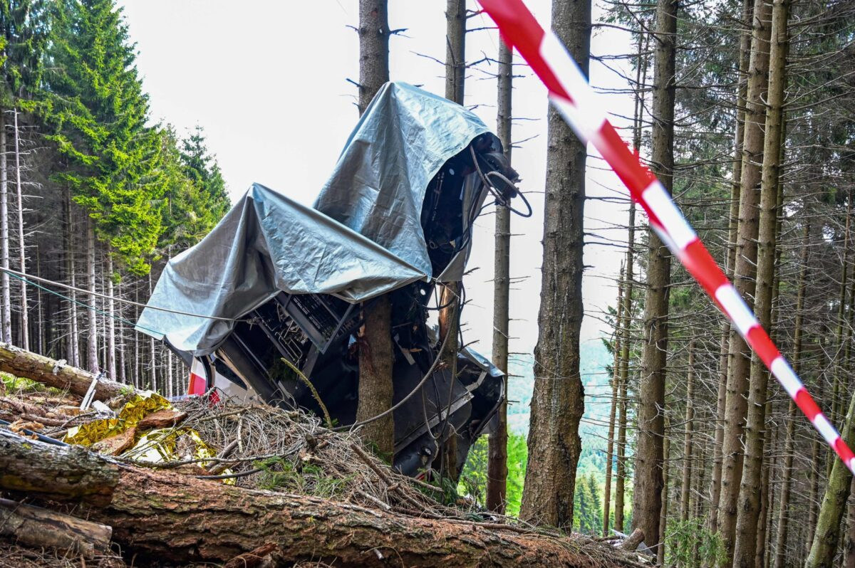 A view shows the cabin's wreckage covered with a tarpaulin on May 26, 2021 on the slopes of the Mottarone peak above Stresa, Piedmont [MIGUEL MEDINA/AFP via Getty Images]
