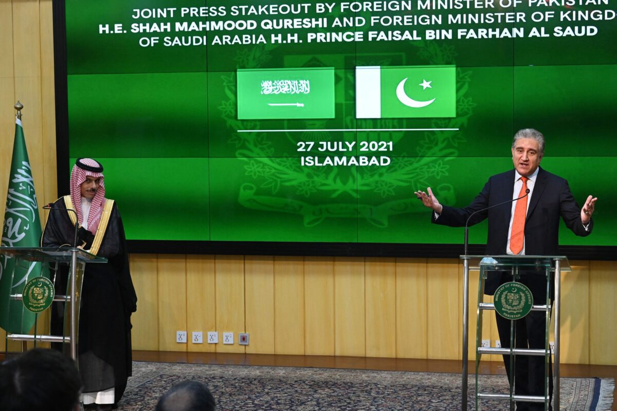 Pakistan's Foreign Minister Shah Mahmood Qureshi (R) and Saudi Foreign Minister Prince Faisal Bin Farhan Al-Saud (L) speak during a joint press conference at the Foreign Ministry in Islamabad on July 27, 2021 [AAMIR QURESHI/AFP via Getty Images]