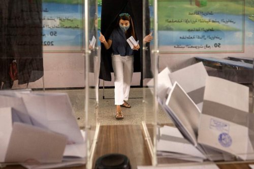 A voter prepares to cast a ballot during Morocco's parliamentary and local elections in the capital Rabat on 8 September 2021. [FADEL SENNA/AFP via Getty Images]