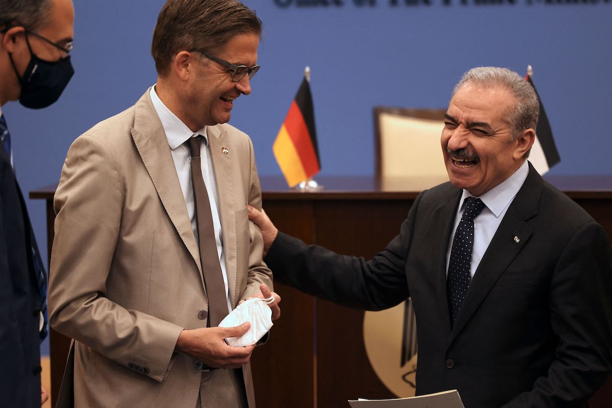 Palestinian prime minister Mohammad Shtayyeh (R) meets with Germany's Ambassador Oliver Ovica in the Israeli-occupied West Bank city of Ramallah on 15 September 2021. [ABBAS MOMANI/AFP via Getty Images]