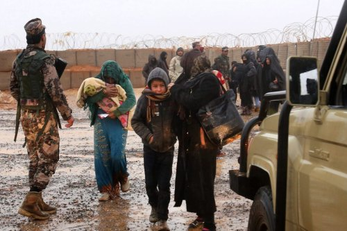 Syrian refugee patients from the makeshift Rukban camp, which lies in no-man's-land off the border between Syria and Jordan in the remote northeast, cross over to visit a UN-operated medical clinic immediately on the Jordanian-side for checkups, on March 1, 2017. Conditions in the Rukban camp deteriorated sharply after Jordan sealed its border almost a year prior, following a cross-border jihadist attack that killed seven Jordanian border guards in June 2016. / AFP PHOTO / KHALIL MAZRAAWI (Photo credit should read KHALIL MAZRAAWI/AFP via Getty Images)