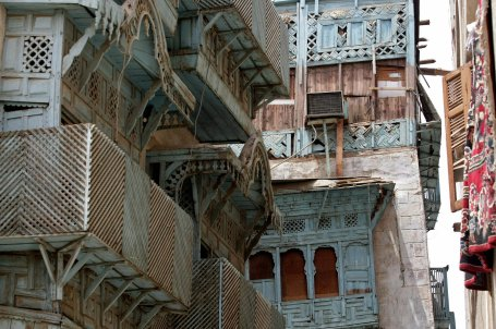 A view shows the carved wood panels decorating the facades of traditional buildings of the Old City in the centre of the Saudi Arabian Red Sea port city of Jeddah, 02 August 2007. The traditional architecture in the Old City of Jeddah was typically built using a stone called 'Manqabi', sourced from various locations such as the AL-Arbain Lake. The process of building involved putting the stones in rows known as 'Madamik' separated by wooden intersections referred to as 'Takail' which were used for distributing the load on the walls equally. The doorways and facades of many of these traditional houses were embellished with decorative stone carvings and wood paneled balconies and 'kiosks'. AFP PHOTO/HASSAN AMMAR (Photo credit should read HASSAN AMMAR/AFP via Getty Images)