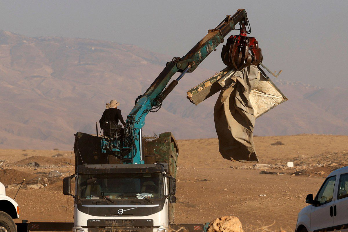 Israeli forces carry out a demotion order in the Jordan Valley on 7 July 2021 [JAAFAR ASHTIYEH/AFP/Getty Images]