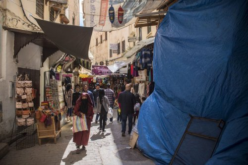 Tourists and locals walk in the 9th century walled medina in the ancient Moroccan city of Fez on 11 April 2019 [FADEL SENNA/AFP/Getty Images]