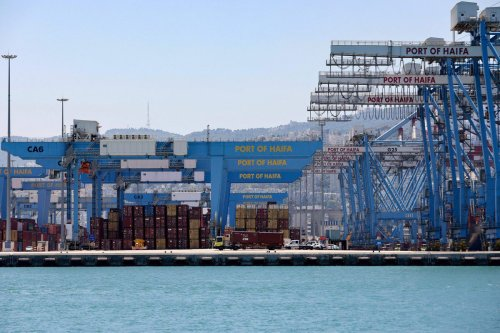This picture shows countainer and cranes on the dock of Haifa port, on 24 June 2021 [EMMANUEL DUNAND/AFP/Getty Images]