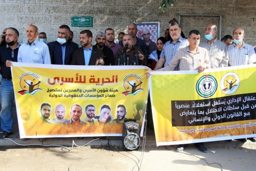 Gazans take part in a protest in solidarity with prisoners on hunger strike at Israeli jails on 25 October 2021 [Youssef Abu Watfa/ApaImages]