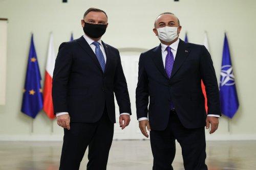 Polish President Andrzej Sebastian Duda (L) receives Turkish Foreign Minister Mevlut Cavusoglu (R) in Warsaw, Poland on October 04, 2021 [Cem Özdel/Anadolu Agency]