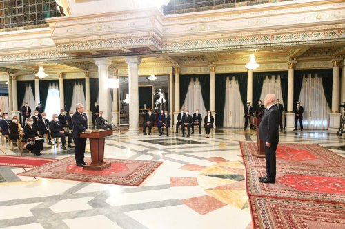 New Foreign Minister Othman Jerandi (at the rostrum) takes oath as President of Tunisia Kais Saied (R) attends the swearing-in ceremony at the Presidential Palace of Carthage in Tunis, Tunisia on 11 October 2021. [Tunisian Presidency - Anadolu Agency]