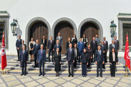President of Tunisia Kais Saied (C) and the new government pose for a photo after the swearing-in ceremony at the Presidential Palace of Carthage in Tunis, Tunisia on 11 October 2021. [Tunisian Presidency - Anadolu Agency]