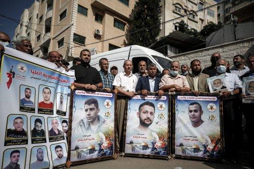 Gazans stage a demonstration in support of Palestinian prisoners in Israeli jails in Gaza City, Gaza on 14 October 2021 [Ali Jadallah/Anadolu Agency]