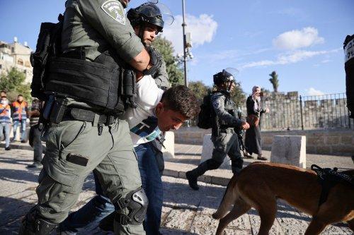 Israeli police arrest a Palestinian boy on 19 October 2021 [Mostafa alkharouf/Anadolu Agency]