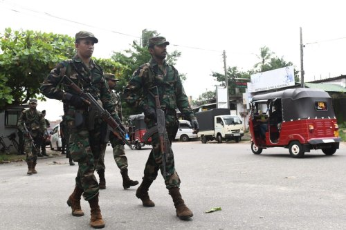 Sri Lankan army soldiers patrol during special cordon-and-search operations in Colombo on May 25, 2019 [LAKRUWAN WANNIARACHCHI/AFP via Getty Images]