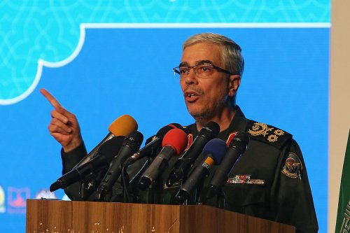 Iranian Armed Forces Chief of Staff Major General Mohammad Bagheri speaks during the the International Conference on the Legal-International Claims of the Holy Defense in the capital Tehran on 23 February 2021. [ATTA KENARE/AFP via Getty Images]